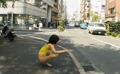 Sweet Asian girl exposes her fine ass on the street